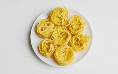 Preparazione Sformato di tagliatelle con pancetta e formaggio - Fase 1