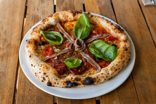Come preparare un'ottima pizza con il forno di casa