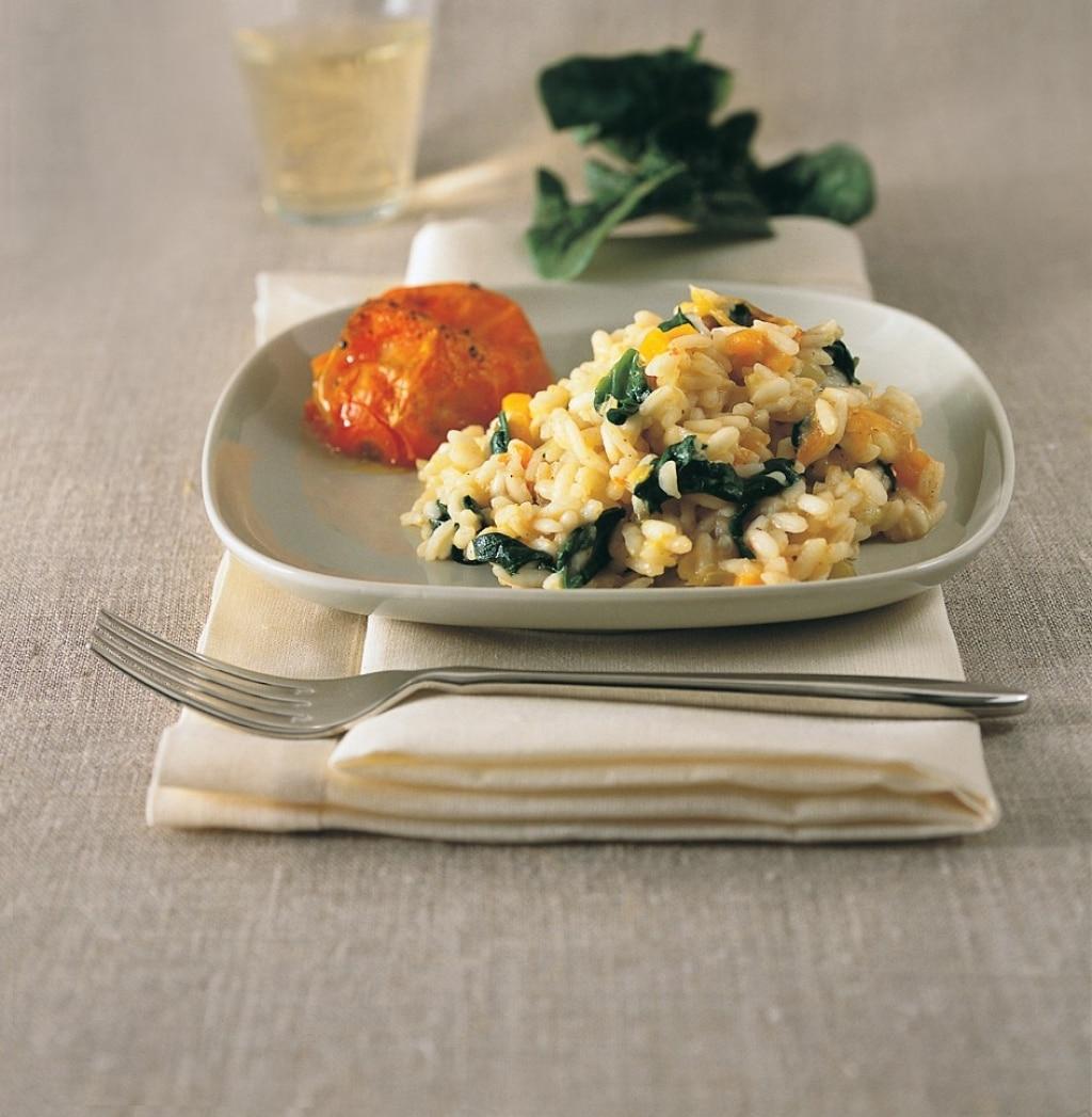 Risotto con spinaci e pomodori