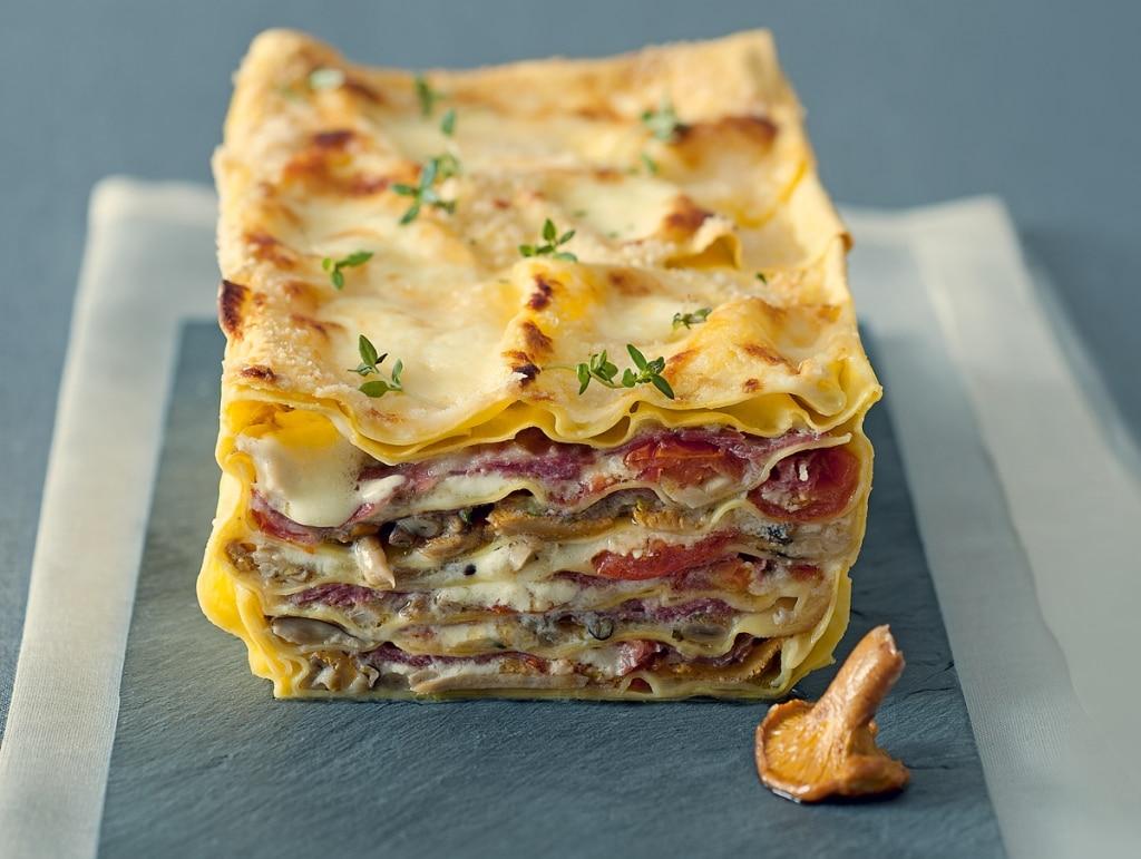 Lasagne ai funghi con pomodorini confit