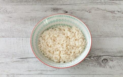 Preparazione Torta salata di pasta sfoglia con riso, spinaci e feta  - Fase 1