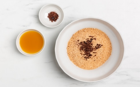 Preparazione Cheesecake di pesche, cacao e amaretti - Fase 1
