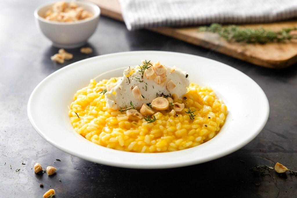 risotto alla crema di zucca con mousse di parmigiano e nocciole